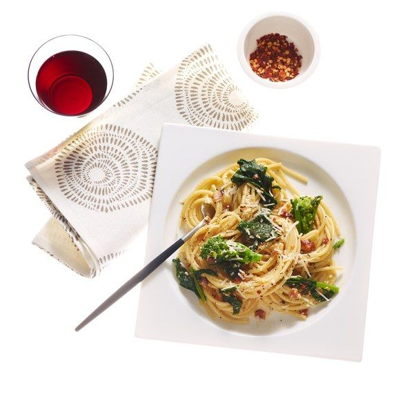 "The warm spaghetti in this dish ""cooks"" the egg mixture to create a silky sauce, just like in a traditional carbonara recipe. Miso paste increases the umami factor and bright broccoli rabe brings freshness to the classic bacon, egg, and cheese combo."