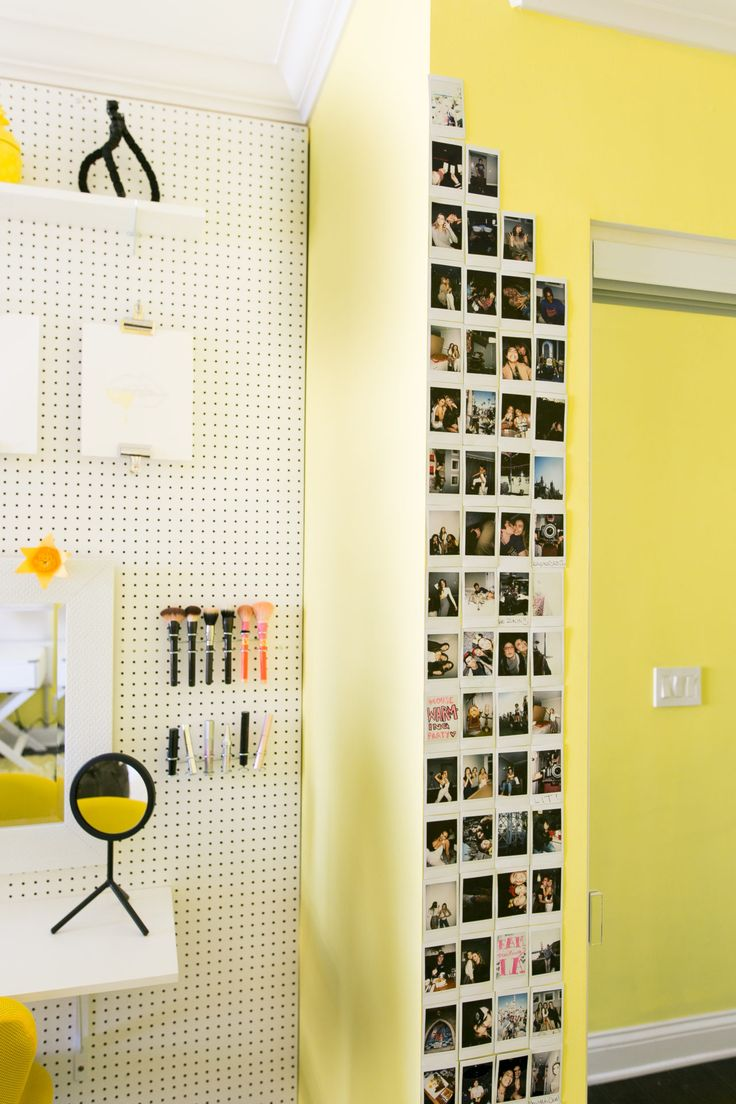 If you have photos, hang them on your wall in a grid or column to show them off!