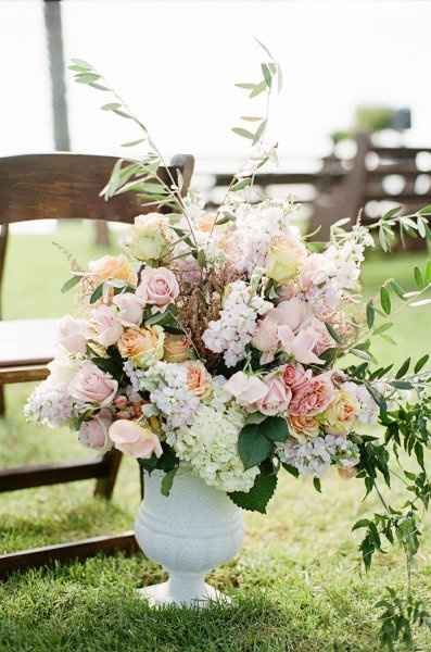 66 best images about ceremony flowers on pinterest for Pastel colored flower arrangements