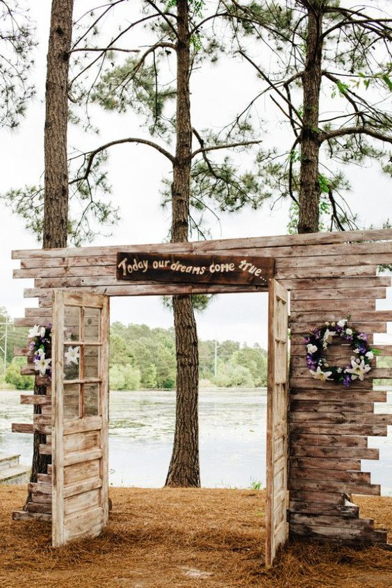 rustic country old door wedding entrance #rusticdecor #rusticwedding #countrywedding http://www.deerpearlflowers.com/wedding-reception-entrance-ideas/