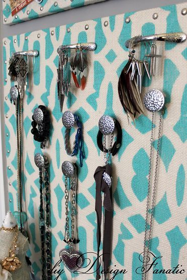 stenciled burlap jewelry holder - I don't think I would make it exactly like this, but it certainly has given me some ideas. His about using old porcelain or glass knobs? Oh the possibilities :)