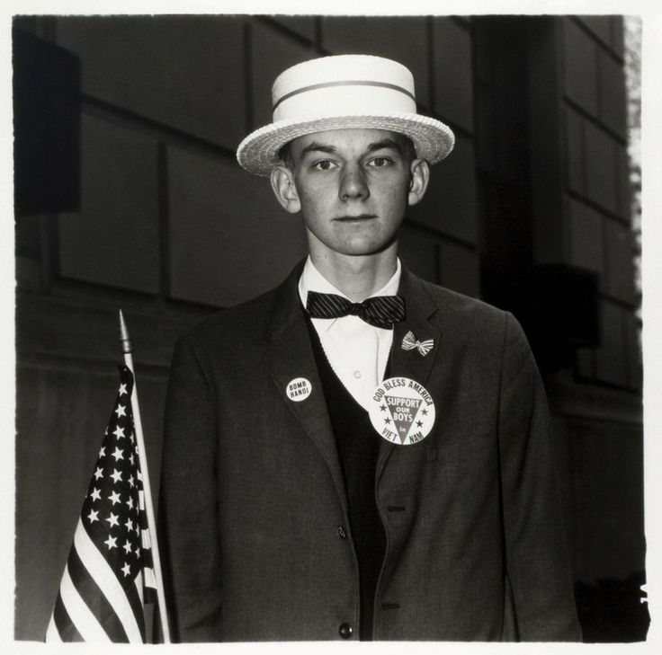 Boy with a straw hat waiting to march in a pro-war parade, NYC (1967)