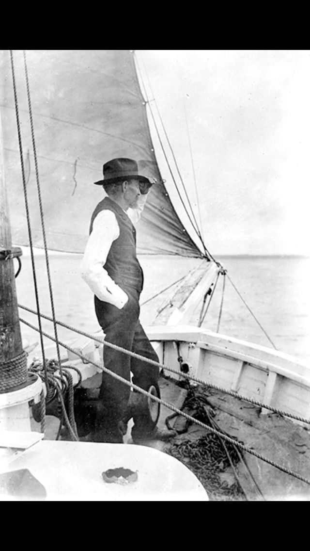 """Joshua Slocum, sailing alone around the world on """"Spray"""" (in hat and vest, of course)"""