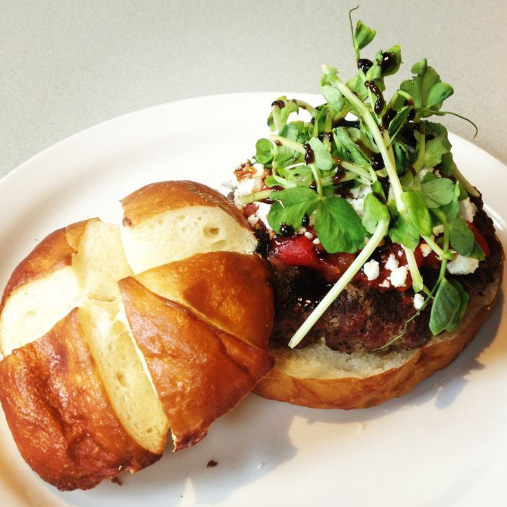 Too pretty to eat? 100 Mile Grille burger with goat cheese and all the fixings.
