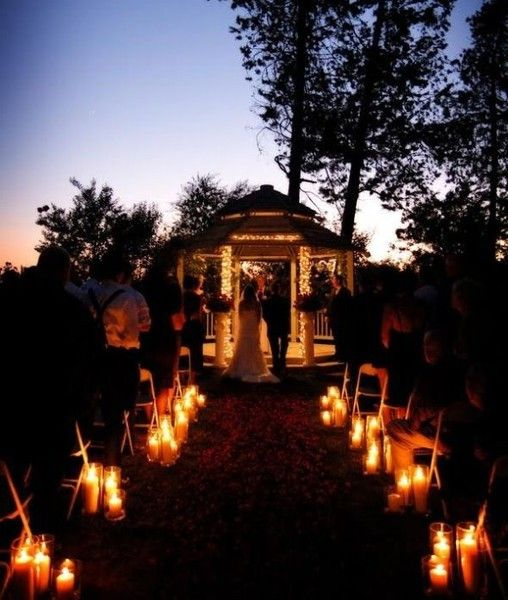 Evening wedding ceremony.  Lighted gazebo. Add PartyLite GloLite pillars and hurricanes to light the aisle. Stunning! Follow at: www.partylite.biz/jenhardy www.facebook.com/partyhardyjen #jenhardyyourcandlelady