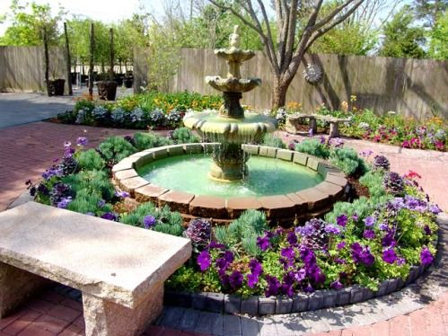 12 best round flower beds images on pinterest flower for Circular raised garden bed ideas
