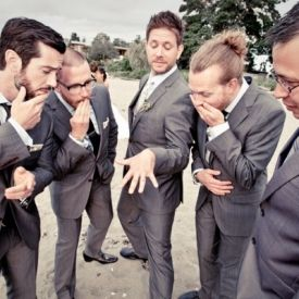 How awesome is this photo of the groom and his groomsmen? Photo by Mark Gutknecht.