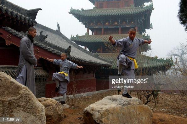 MONASTERY, ZHENGZHOU, HENAN, CHINA - : Shaolin Monastery or Shaolin Temple, a Cha?n Buddhist temple on Mount Song, near Dengfeng, Zhengzhou, Henan province, China Shaolin monks train in Kung Fu at Shaolin Monastery or Shaolin Temple, a Cha?n Buddhist temple on Mount Song, near Dengfeng, Zhengzhou..