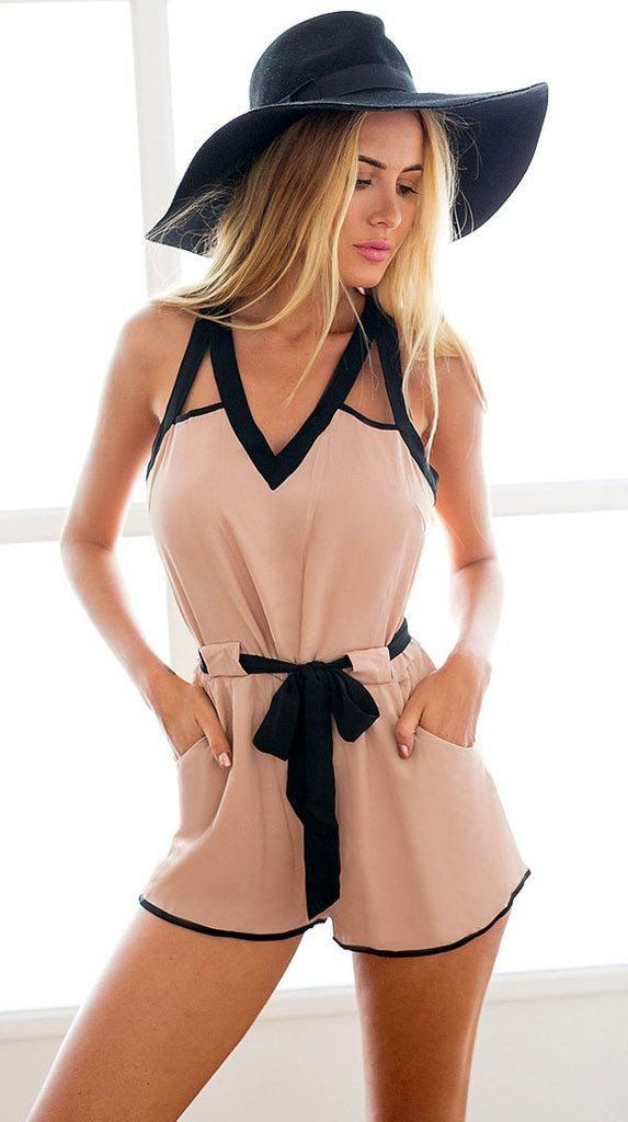 Can't decide what to wear on a date? Choose this slit back romper! What makes this piece as must have is that it's not only great for casual wear, but the V-neckline and the cutout at the back makes this romper perfect for any cocktail parties. It also has a loop-button closure for easy wear, and two slanted front pockets for extra detailing. Wear this romper with flats or with bright shoes for a quirky yet grown-up outfit.