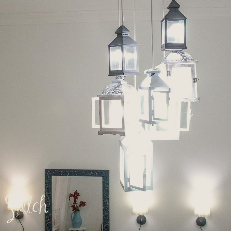 Upcycled mirror frame with clay decorations, lanern chandelier.