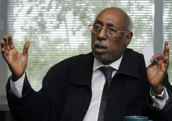 Abukar Hassan Ahmed talks about the civil court case against former Somali Col. Abdi Aden Magan during an interview at The Associated Press bureau in Columbus, Ohio. Ahmed is seeking damages against Magan, who was found responsible last year for torturing Ahmed in the 1980s.