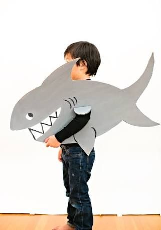 Instead of arm hole, add a handle or 2 on the back for the child to hold the fish...