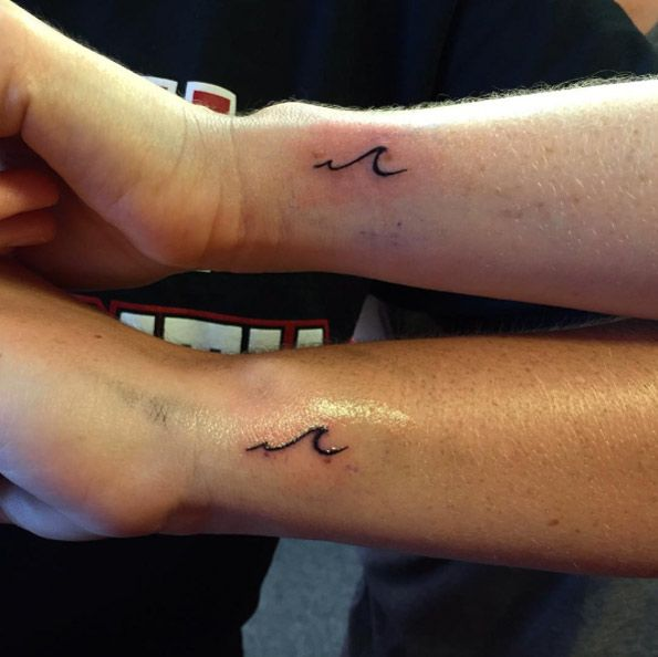 Matching tiny wave tattoos on wrist by Rebecca Fedun