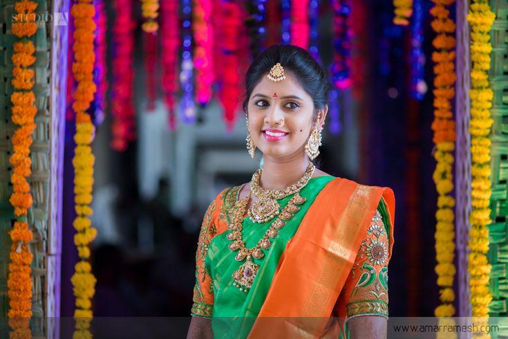 South Indian bride. Gold Indian bridal jewelry.Temple jewelry. Jhumkis. Orange and green silk kanchipuram sari.Braid with fresh jasmine flowers. Tamil bride. Telugu bride. Kannada bride. Hindu bride. Malayalee bride.Kerala bride.South Indian wedding.