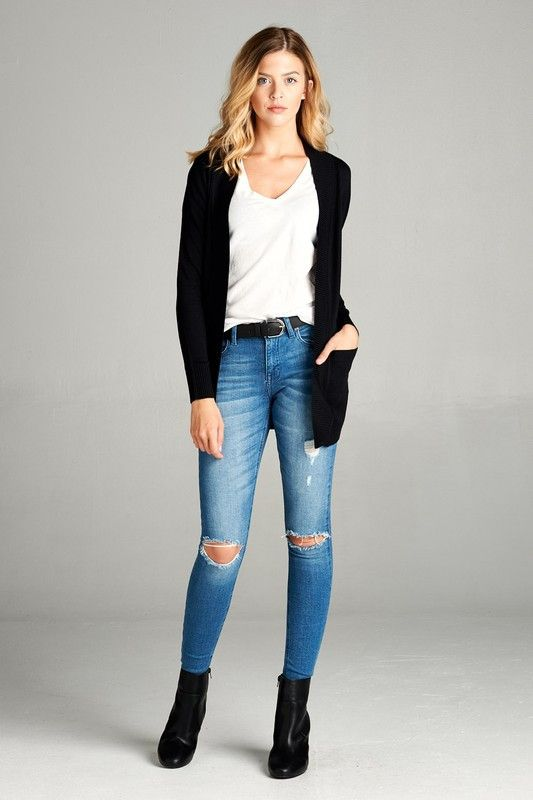 The black cardigan is a closet staple. I love this one because it's lightweight, the perfect length, and it has pockets! - Open cardigan sweater with a ribbed band and full length sleeves. - True to s