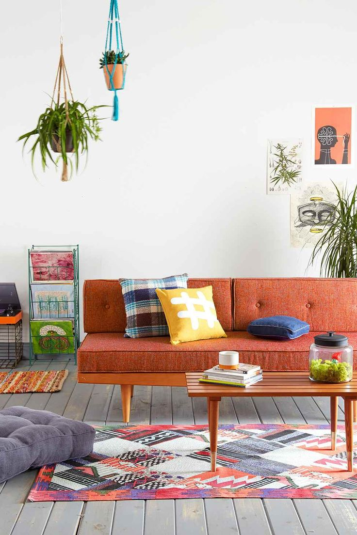 Colourful Interior Inspiration | Mid Century Sofa in Orange, patterned rug and dual coloured print cushions