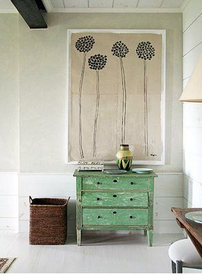 { Painted green } I like the wall art in the back ground.  Using trim to frame in an area and paint simple flowers, would be a good way to use up the tall walls in the living room.