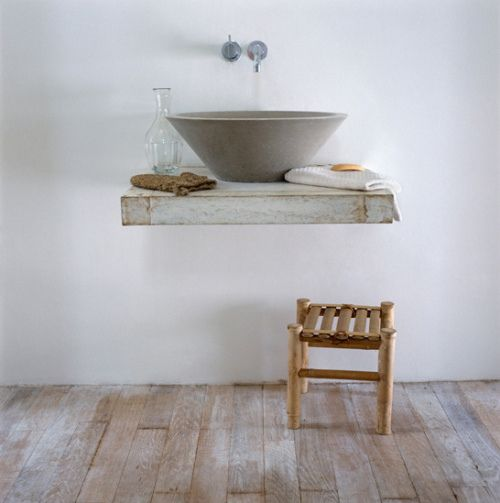 Sink made from stone or concrete, which combines beautifully with wood.