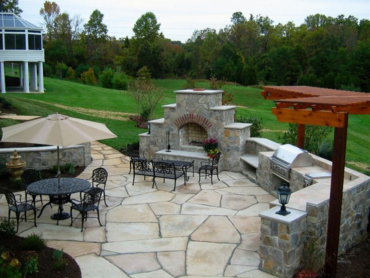 This Outdoor Kitchen And Patio, Designed For Entertaining, Is Accessible  From The Deck,