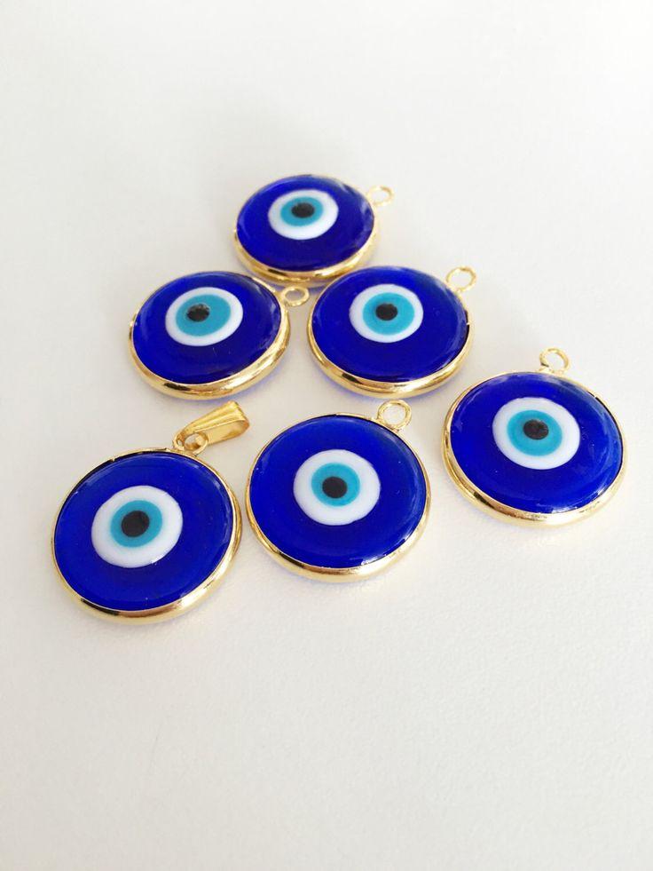 https://www.etsy.com/listing/475334251/2pcs-gold-plated-evil-eye-pendants-22mm 2pcs gold plated evil eye pendants, 22mm turkish handmade evil eye charms, glass evil eye charms, gold nazar evil eye charm, 24K matte gold evil eye The listing include 2 evil eye charms They are 22mm diameter. #evileye #evileyes #evileyebead #goldbead #murano #muranoglass #glassevileye #blueevileye #bluebeads #beads #charm #evileyecharm #necklacecharm #necklace #diy