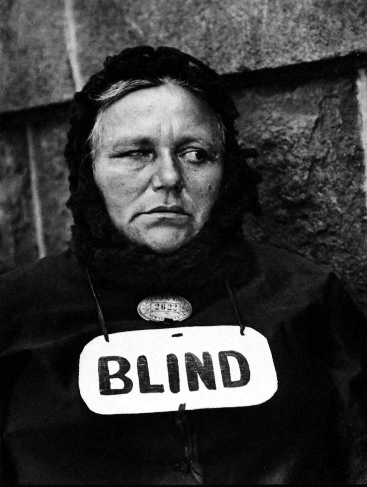 Paul Strand - Blind Woman, New York  (1916). Strand tricked his subjects by mounting a fake lens on his camera at a 90 degree angle and capturing unflinching reality. He believed in socio political reforms and used photography to influence. Even though the blind sign is so visible, ones eyes draws to the prominence to the face. Strand believed even in that misery, her was face was full of nobility.