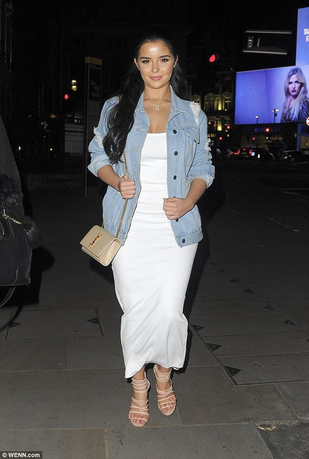 Curvaceous: Demi Rose Mawby, 22, accentuated her sizzling curves in a figure-hugging maxi dress for a night on the town in London on Friday