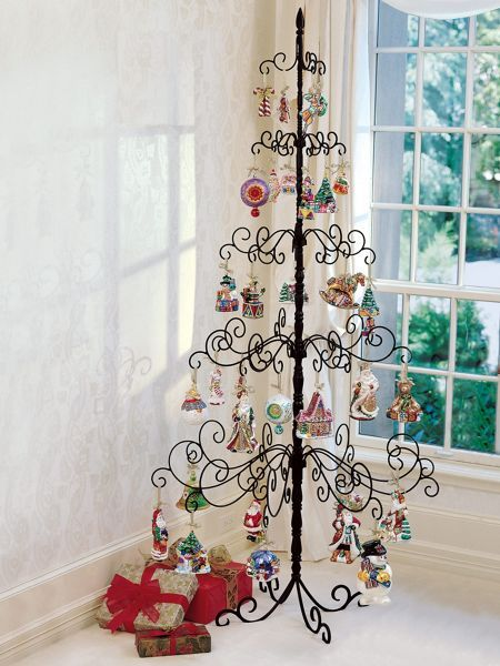 Showcase ornaments on the original sturdy wrought iron tree. Even large ornaments won't look crowded on the sturdy black metal