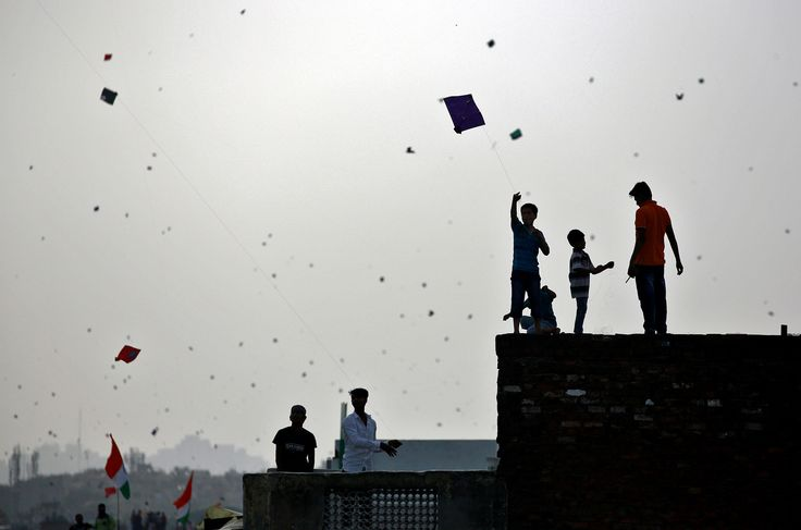 People fly kites from rooftops in Old Delhi as they celebrate Independence Day in India on August 15, 2017.