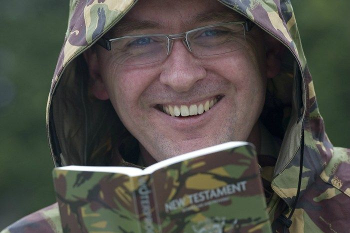 NZDF Chaplain Class One Lance Lukin (NZ Defence Force) with the world-first purpose made military New Testament