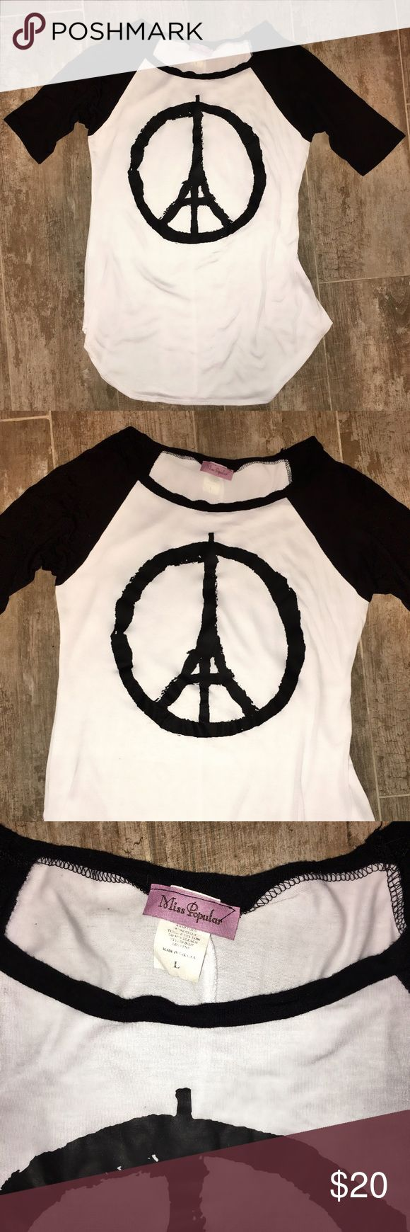 """Miss Popular """"Paris Peace"""" 3/4 Sleeve T-Shirt Sz L Miss Popular """"Paris Peace"""" 3/4 Sleeve T-Shirt Sz L - Black/White - Worn Once - *French graphic designer Jean Jullien created the image, """"Peace for Paris"""", and posted it on Twitter and Instagram at midnight after the attacks. It has been embraced by the world as the symbol to show solidarity with the City of Light and has been printed on t-shirts, posters and flags, and been shared across social media along with the hashtags #PrayforParis and…"""