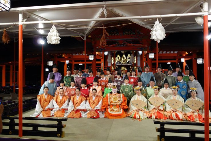 A group of people dressed in heian robes for a concert.