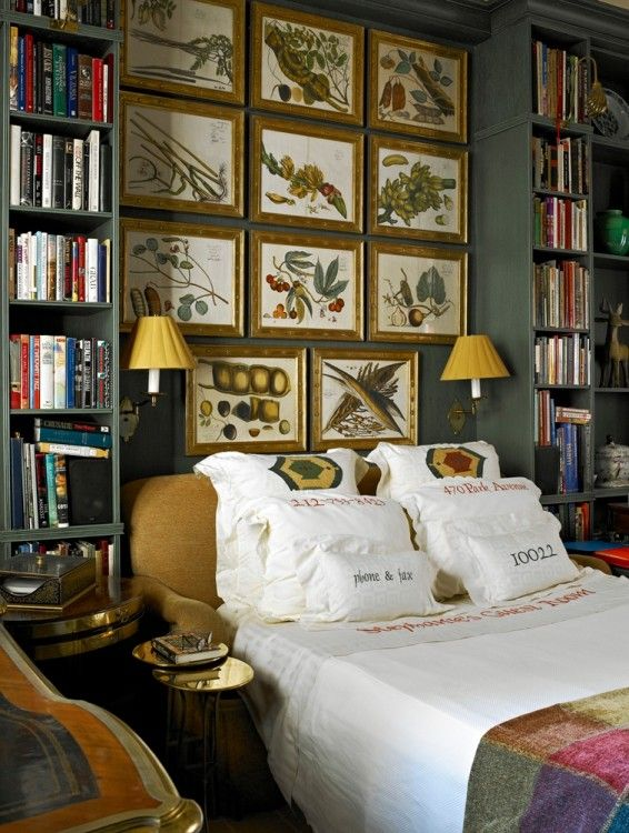 Cozy bedroom with artwork, sconces, bookshelves
