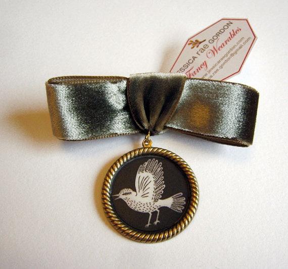 Bird on a brooch