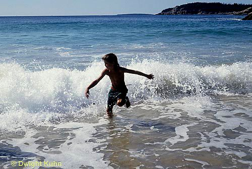 Shorebreak sprint  ON03-031z  Ocean - boy running in surf, waves breaking