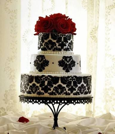 Gorgeous cake! These were the colors I originally wanted to do (black and white with red accents.) Really love the damask...: