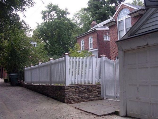 Picket Fence On Top Of Stone Wall Fences And Gates