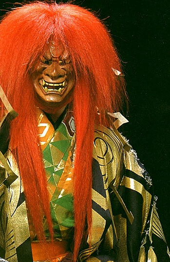 Noh   livid orange color to lion character may be a more recent attribute.