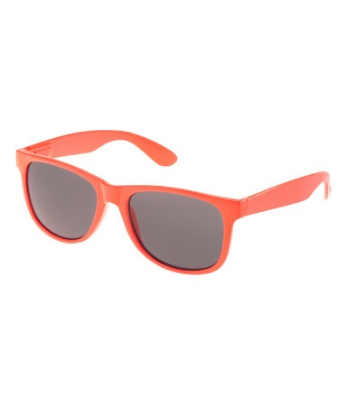 Sunglasses with plastic frames and tinted lenses. UV protection