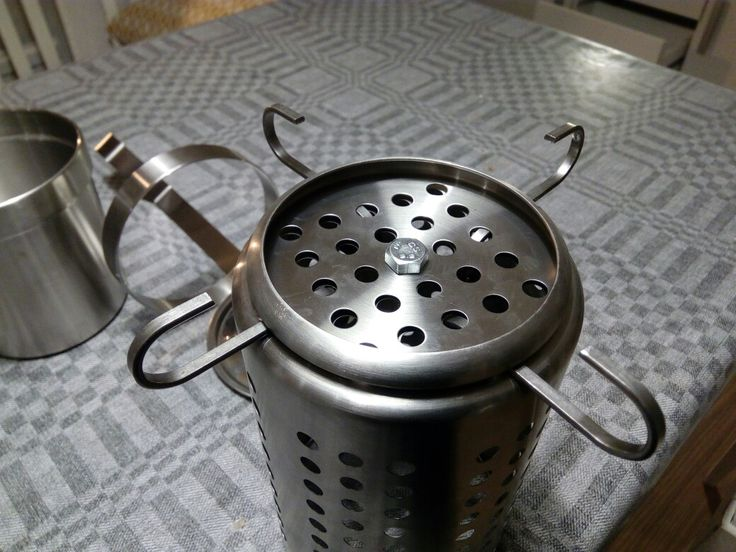 "Ikea hobo stove folding legs, using only ikea parts, and bolts together. Uses the cutlery stand, the perforated disk included in the Grundtal ""cooking pot"", 4 Grundtal S-hooks and an M8 bolt and nut (or 5/16"" if you're not metric)"