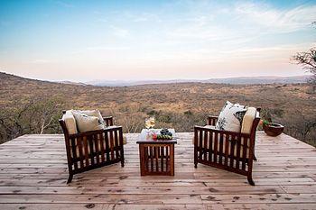 Relax on the deck at Rhino Ridge Safari Lodge - Hluhluwe iMfolozi Game Reserve