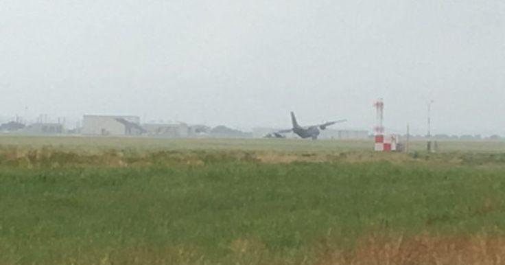 Australian Air Force plane blows tires on Waco runway; flights halted.