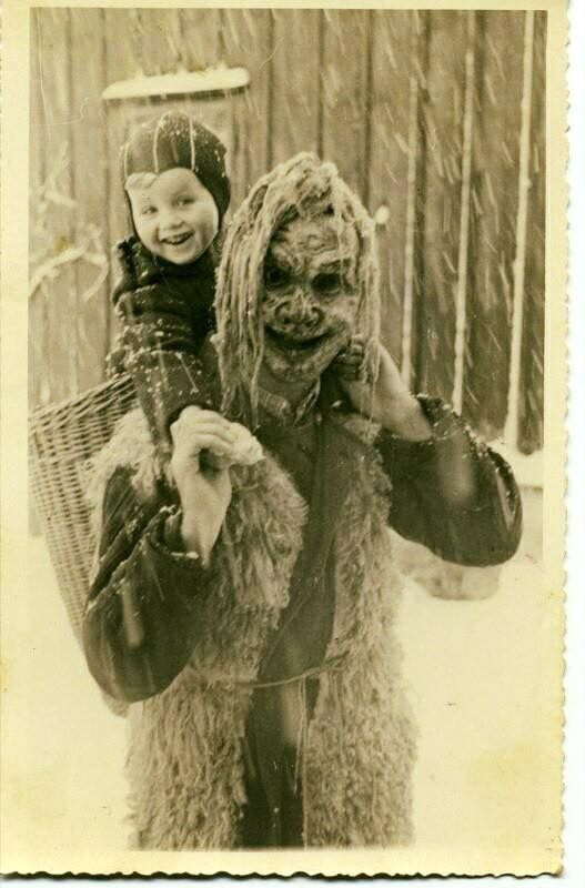 A creepy photo that was recently discovered in a thrift store. Only the year 1922 is found written on the back.  The character is probably Krampus around the Christmas season.