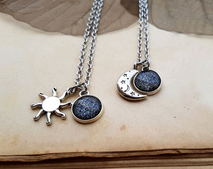 Wonderful set of 2 Sun and Moon Necklaces in silver tone with glass cabochons hand painted with the Dark Moon color, characterized by a dark silver background, which changes his color depending on how it is affected by the light, unleashing fantastic shades ranging from green to blue to gold!  Even when someone is miles away, always remember that we are under the same sky, looking at the same sun, moon and stars  These dainty necklaces are the perfect gift for you and your beloved ones, best…