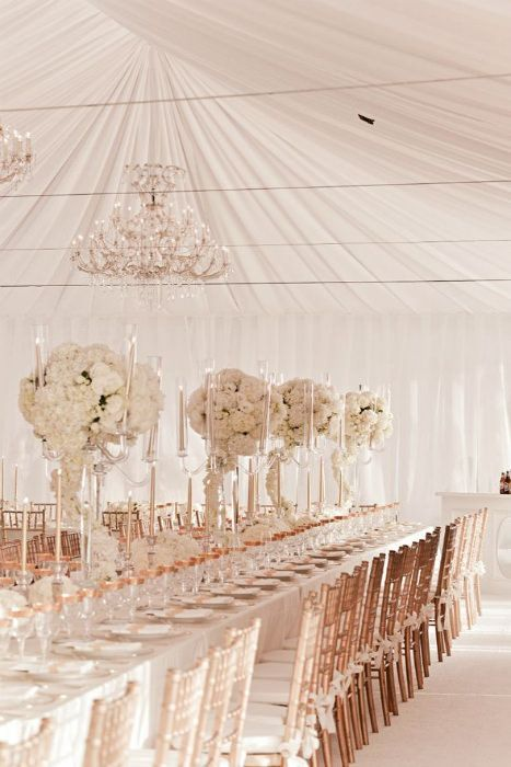 Beautiful gold and white themed reception tent - love the towering centerpieces…