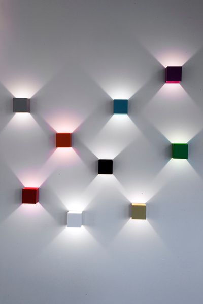 Lux is a simple wall lamp which produces a decorative lighting effect. As they rotate 360 degrees you can arrange a real light show / lacquered aluminum / available in 13 colours