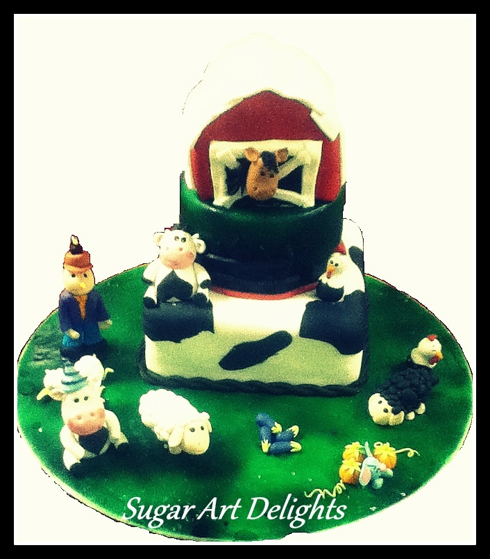 A barn house themed cake with all edible animals