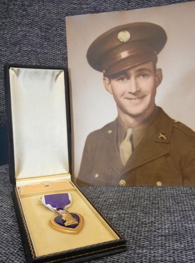 In this photo of June 28, 2013 provided by Goodwill Industries in Buffalo, N.Y. shows Pvt. James Roland and the Purple Heart medal he earned serving in World War II. The medal was found in June by Goodwill employee Richard Zuehlke while unpacking donations. The medal will be presented to Roland's cousin, Mary Roland Struble, on Saturday, Aug. 17 during a ceremony in Westover, Pa. (AP Photo/Goodwill Industries of Western New York)
