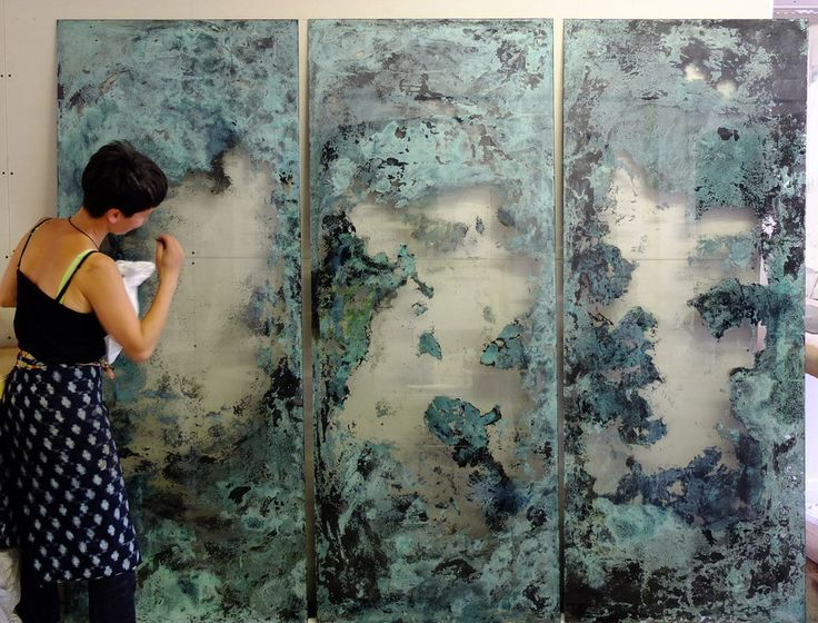 Emma Peascod working on copper verdigris panels, a custom design for a private residence in London. Replicate this look with copper leaf on glass? Looks like Verre Eglomise