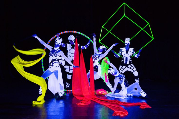 Black light dancers Anta Agni in Crystal Light Show. Cyr wheels, cubes, ribbons, led props.