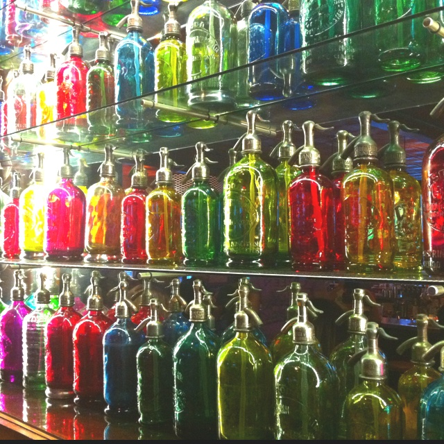 Obsessed with antique seltzer bottles: a rainbow of them on display at Local 149 in South Boston.